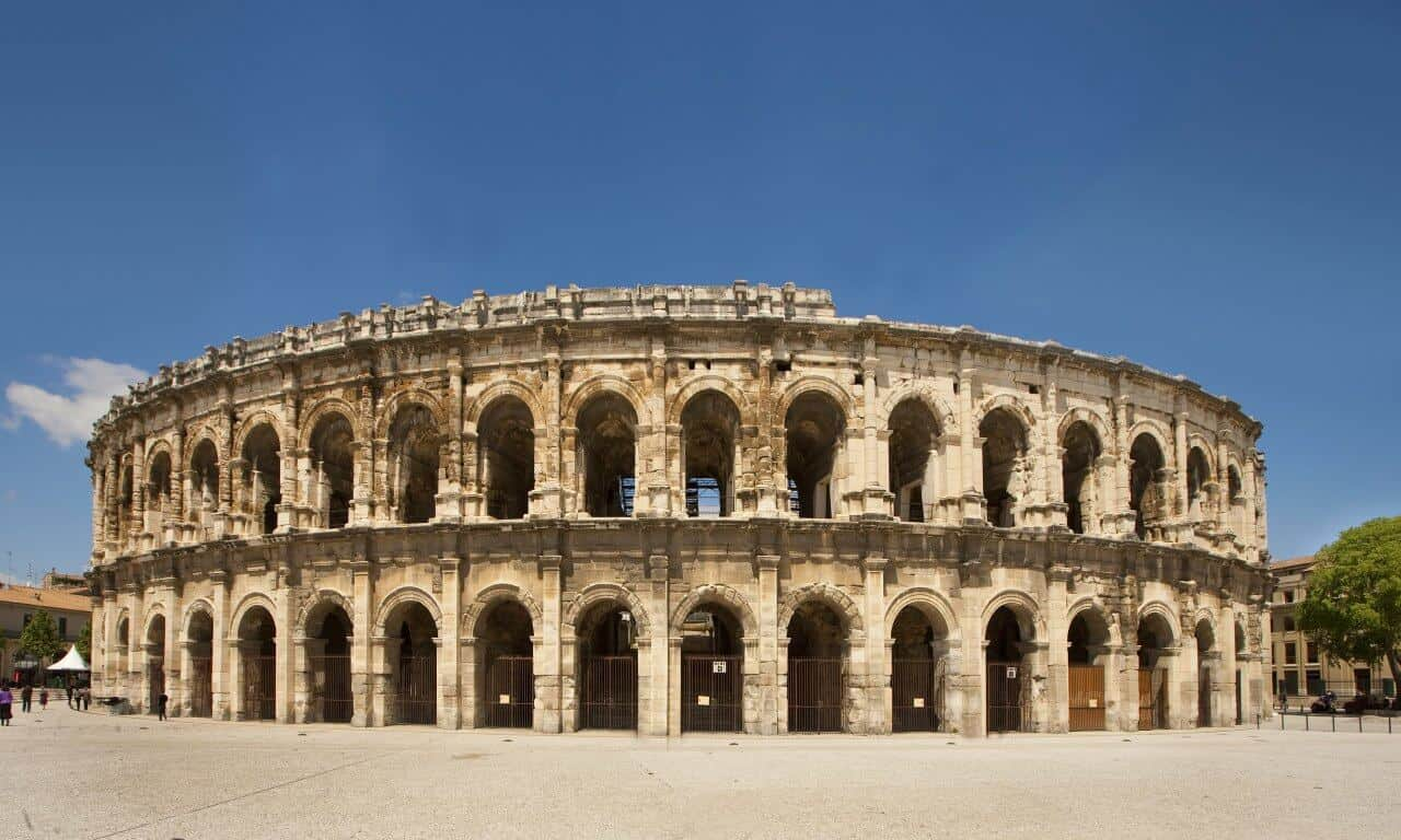 The Arena in Nimes against a blue sky.