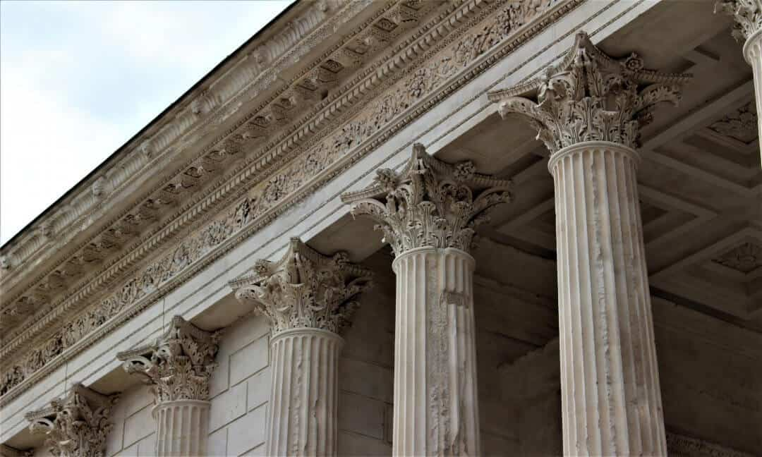The ornate tops of the columns on Maison Carree.