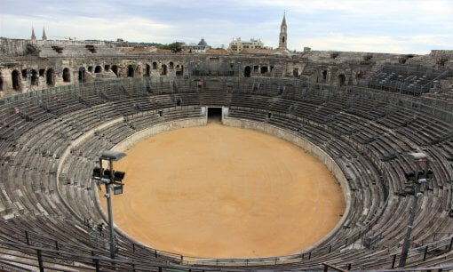 Inside the Roman Arena showing the oval shape, sand covered floor and all of the seats.
