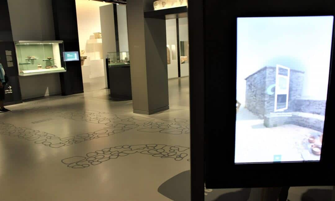 An interactive screen that can move around the outlines on the floor to see how the iron age house would have looked.