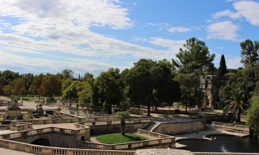 A wide view of the Jardins de al Fontaine showing all of the steps, the source and the temple.