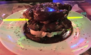 A large profiterole with a glow stick through it.
