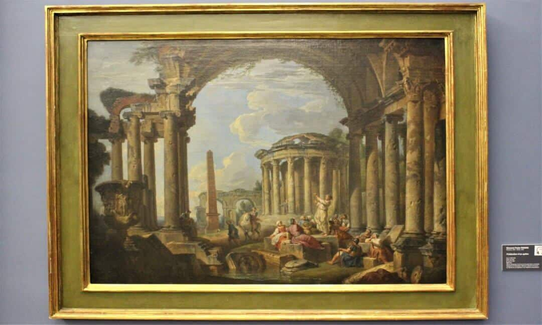 A painting of Roman ruins in a gilt frame.