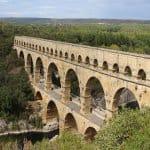 The Pont du Gard Roman bridge near Nimes against a blue sky.