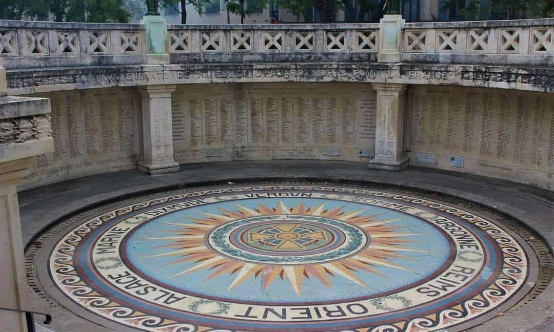 A mosaic floor sunk into the ground in the war memorial in Nimes.