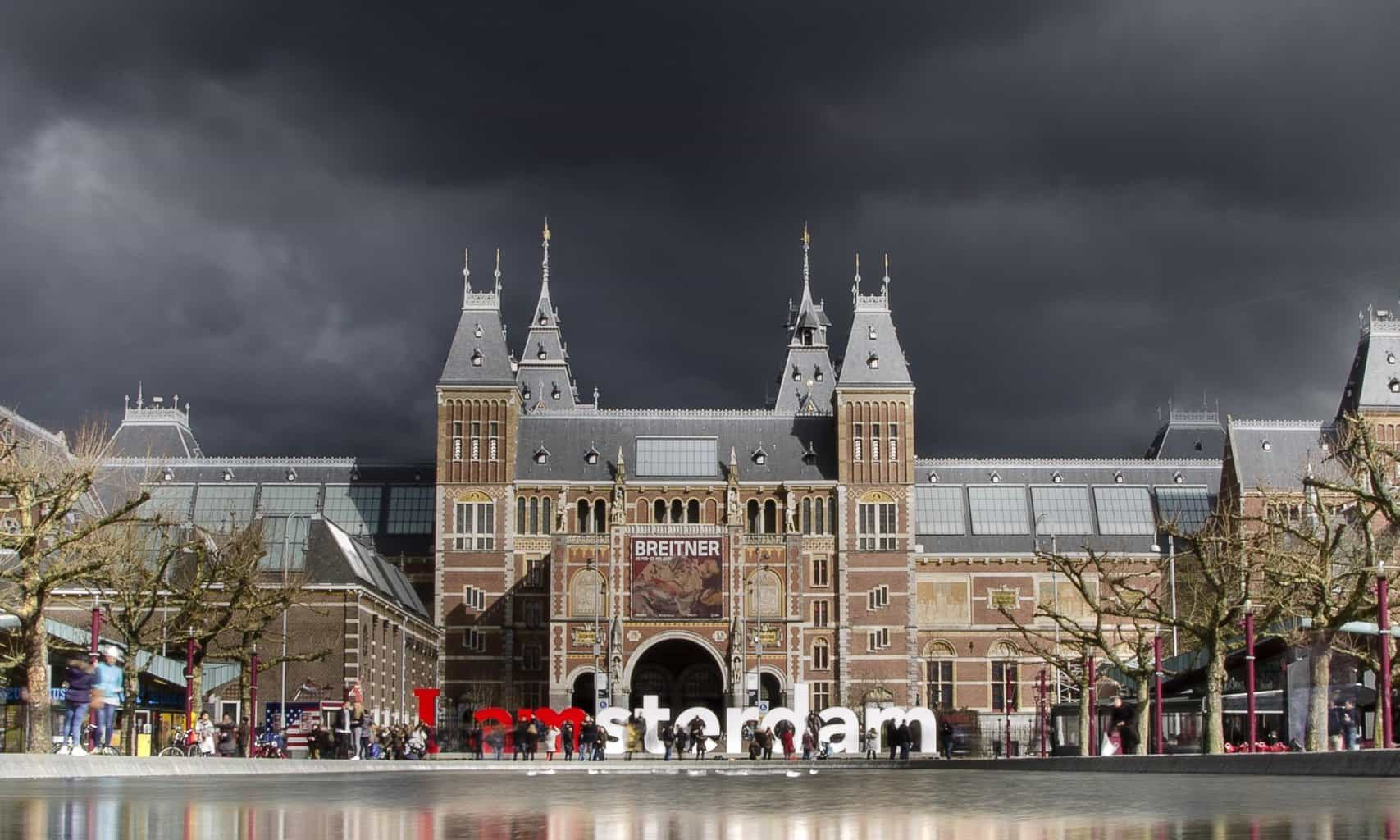 The Rijksmuseum under a dramatic sky in Amsterdam.