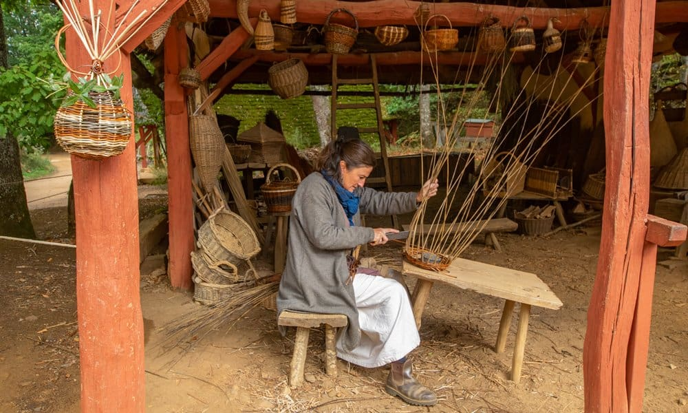 A weaver making a basket.