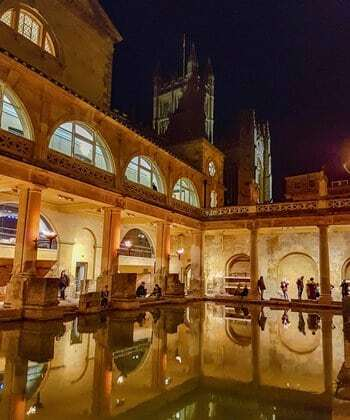 The Roman baths at night, in the city of Bath.