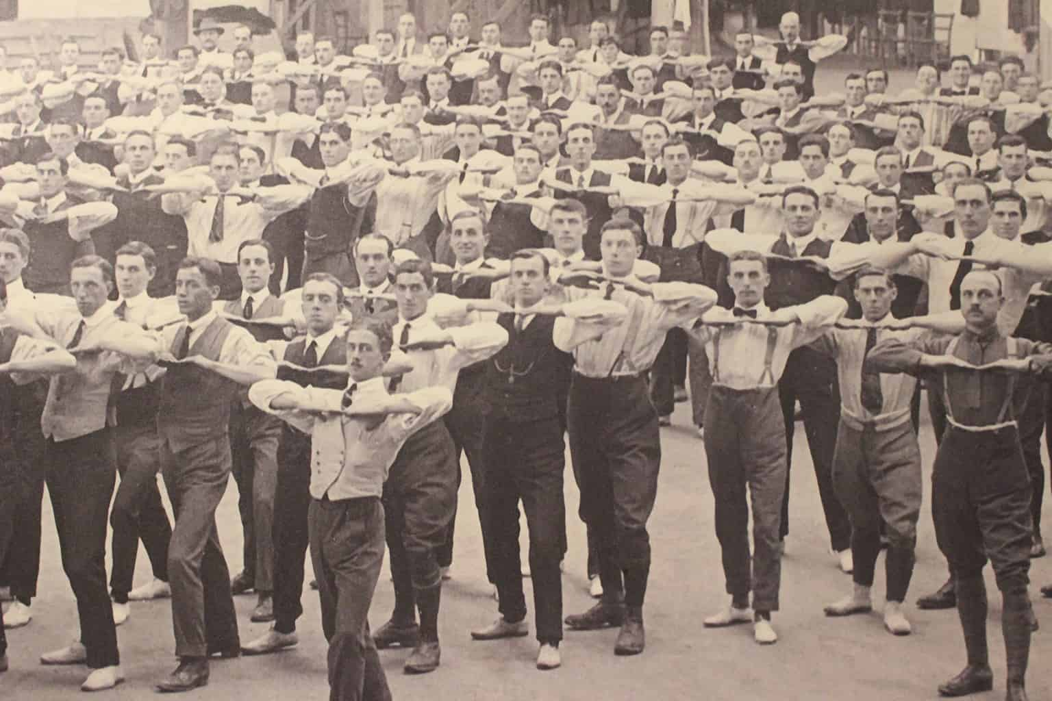 A black and white photo of soldiers exercising before World War I.