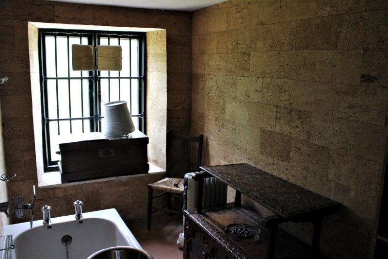 Inside the bathroom at Clouds Hill showing the cork walls and a large window.