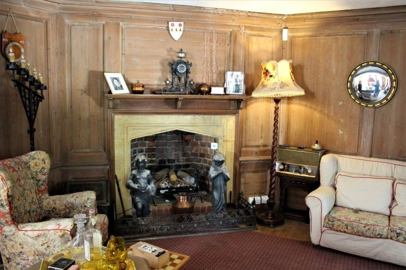 Inside the billiard room at Nuffield Place showing the fireplace and furnishings.
