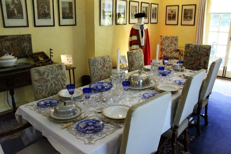 Inside the dining room showing a laid table and his baroncy robes.