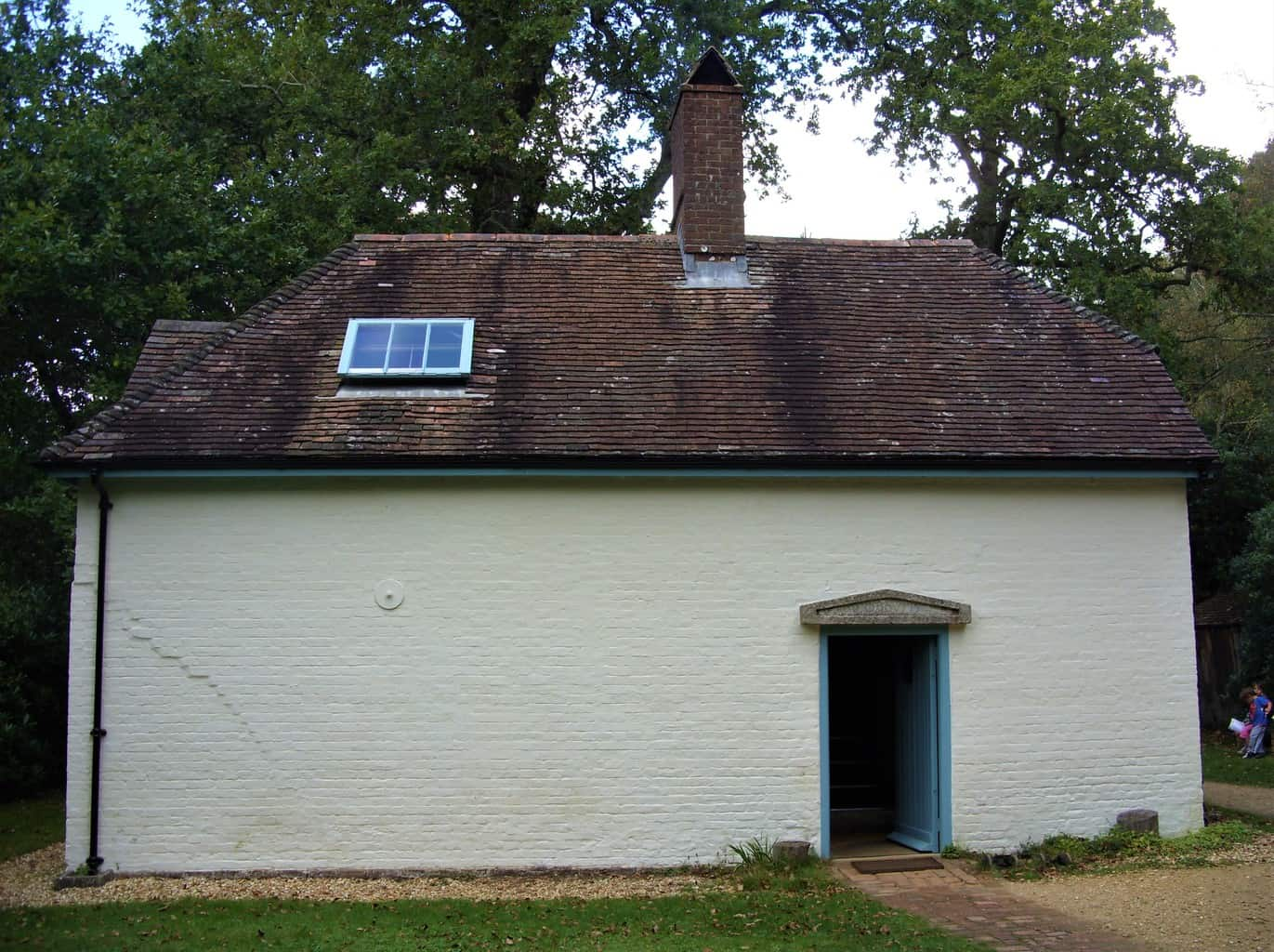 The outside of Clouds Hill showing just a door and an attic window.