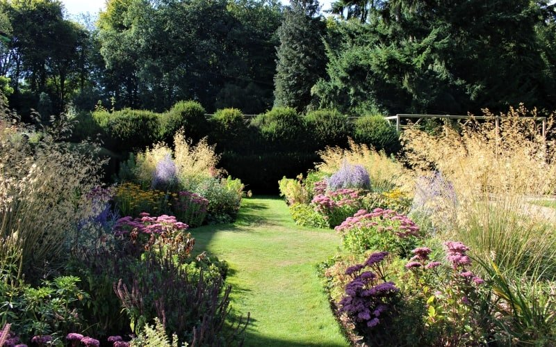 The flowerbeds and tress in the grounds of Nuffield Place.