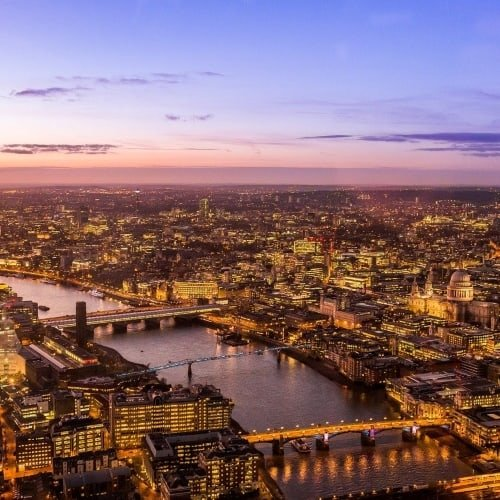 A view over London and the River Thames at sunset.