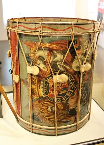 A highly decorated drum.