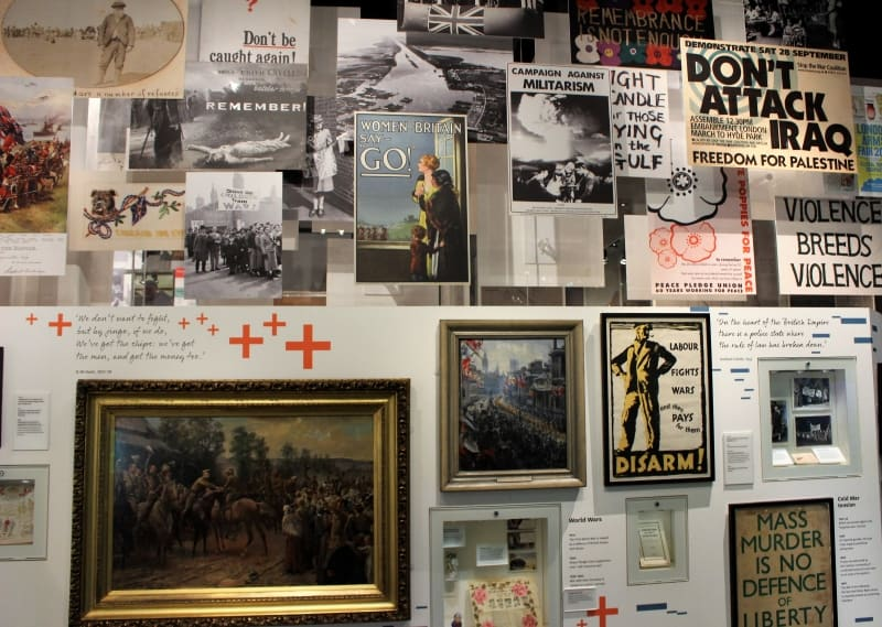 Posters and paintings intermingled ona wall at the National Army Museum.