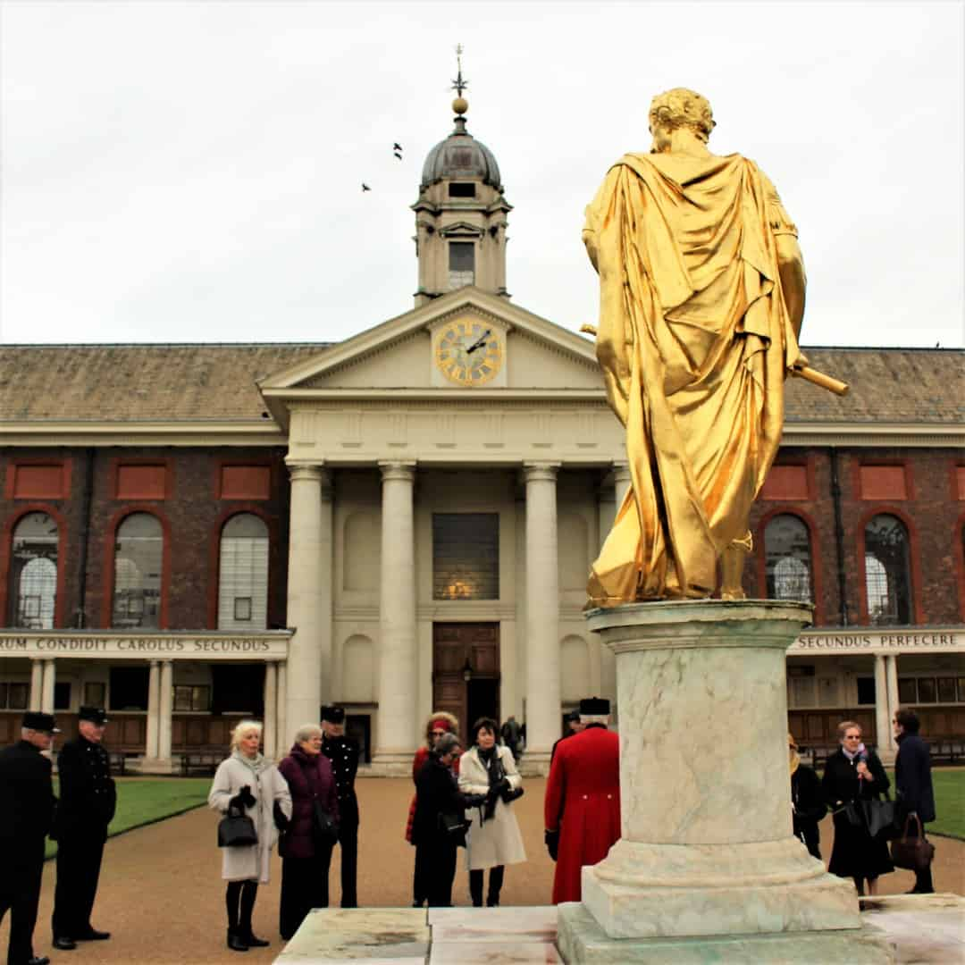 A gold statue outside the Royal Hospital in Chelsea.