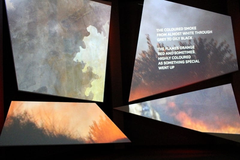 The angular screens in the National Army Museum showing images of warfare.