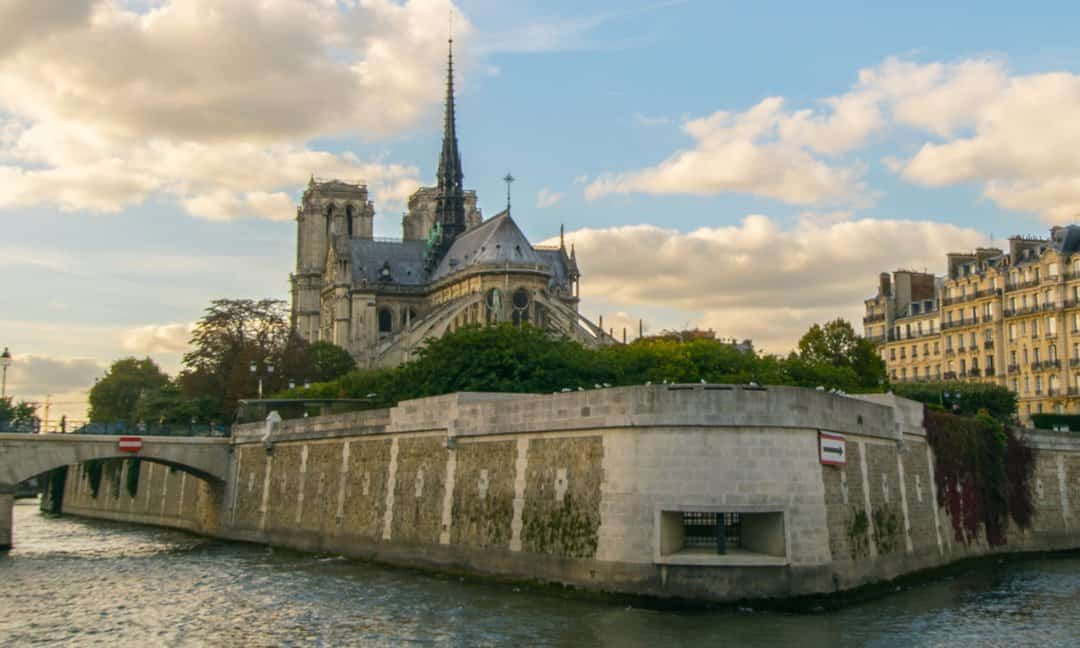 The Memorial to the Martyrs of Deportation and the Notre Dame Cathedral from the Seine River.