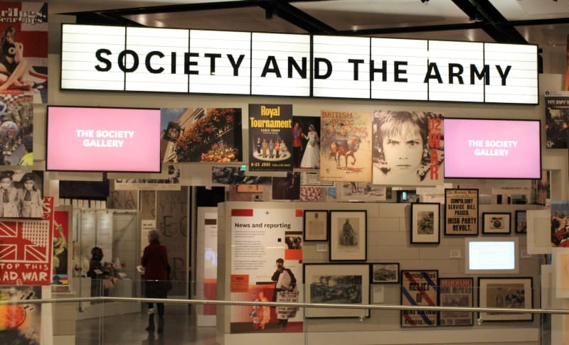 Outside the Society Gallery in the National Army Museum showing the posters and screens.