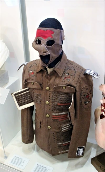 A World War 1 uniform with lots of stitching on it.