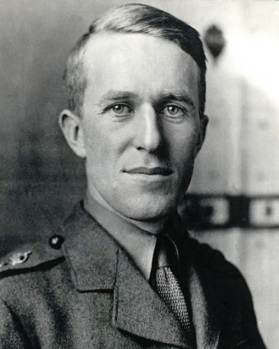A black and white portrait of Lawrence in army uniform.