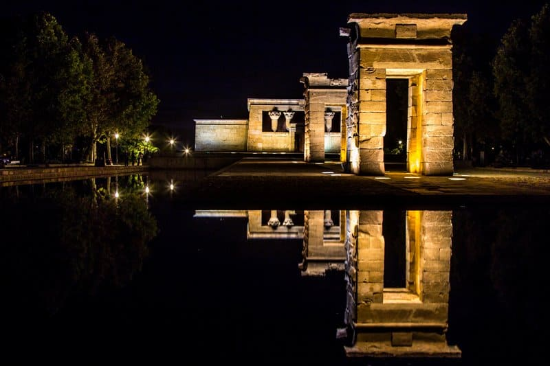 The beautifully lit Temple of Debod by night.