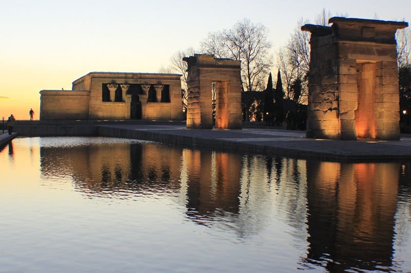 Temple of Debod with the sun setting behind it.