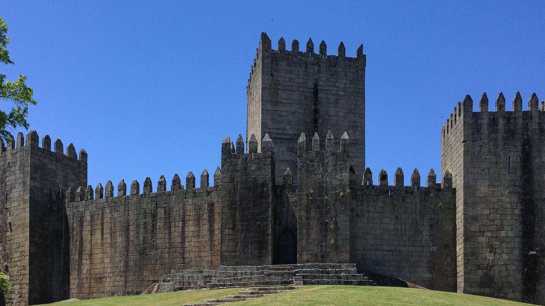 Imposing walls of the Medieval Castle of Guimarães in northern Portugal.