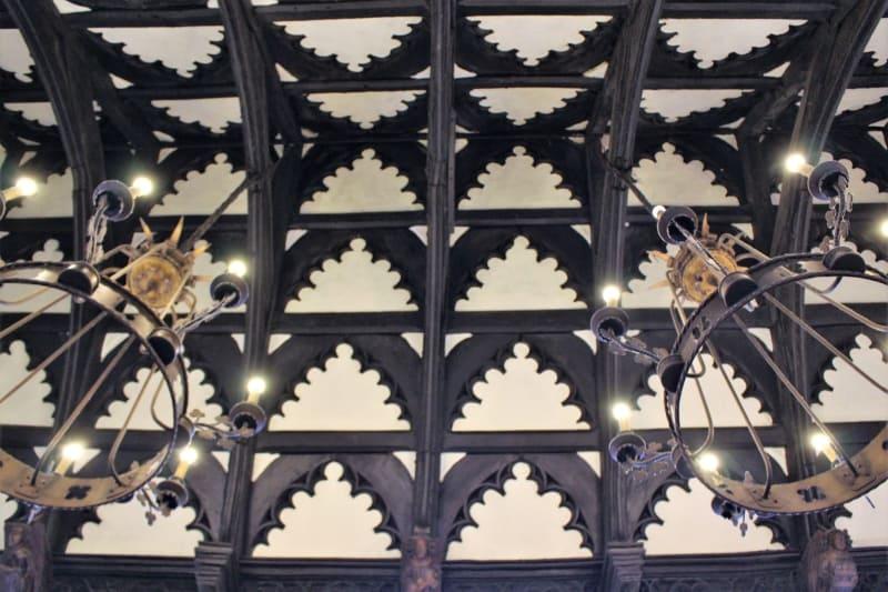 Detail of the ceiling showing the dark oak beams in John Halle hall in Salisbury.