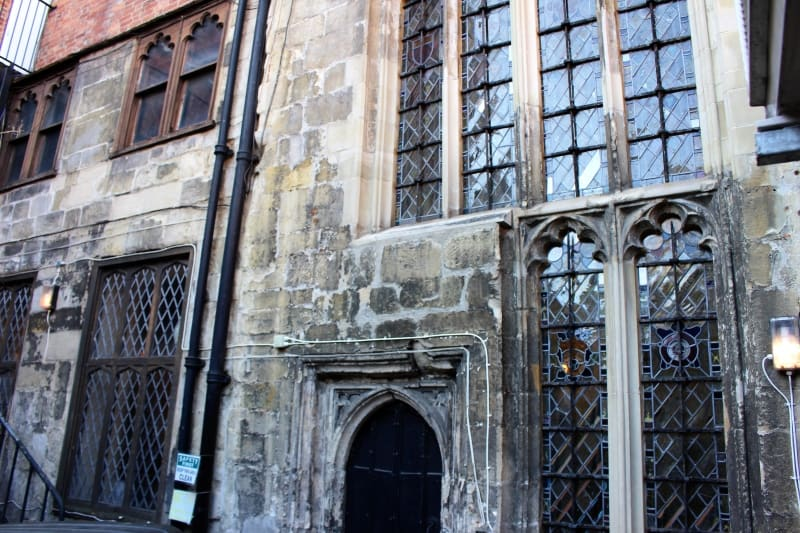 The outside wall of the Medieval hall of John Halle in Salisbury.