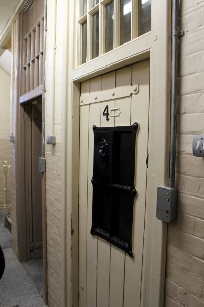 The passageway with jail cell doors coming off.