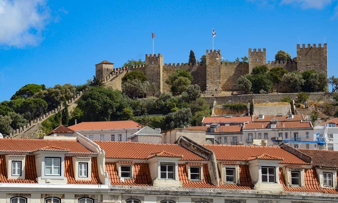 The walls of the Moorish São Jorge Castle rise above the city of Lisbon, Portugal.