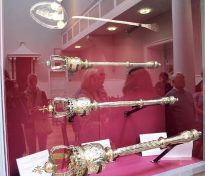 The silver maces and a giant spoon in a display cabinet in Salisbury Guildhall.