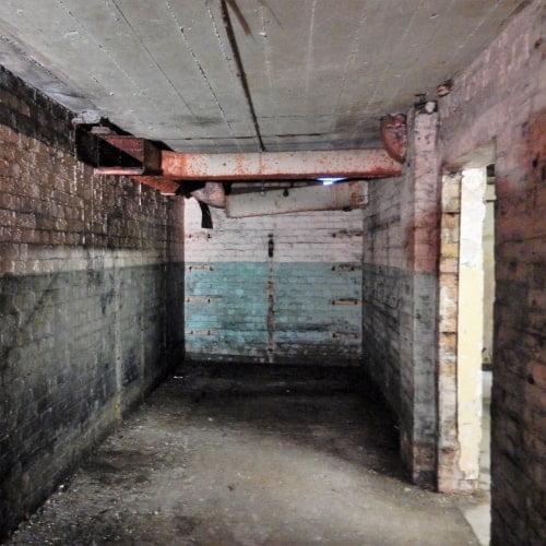 A brick tunnel inside Branton Quarry Bunker in Edinburgh.