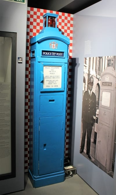 A bright blue police post box used in London.