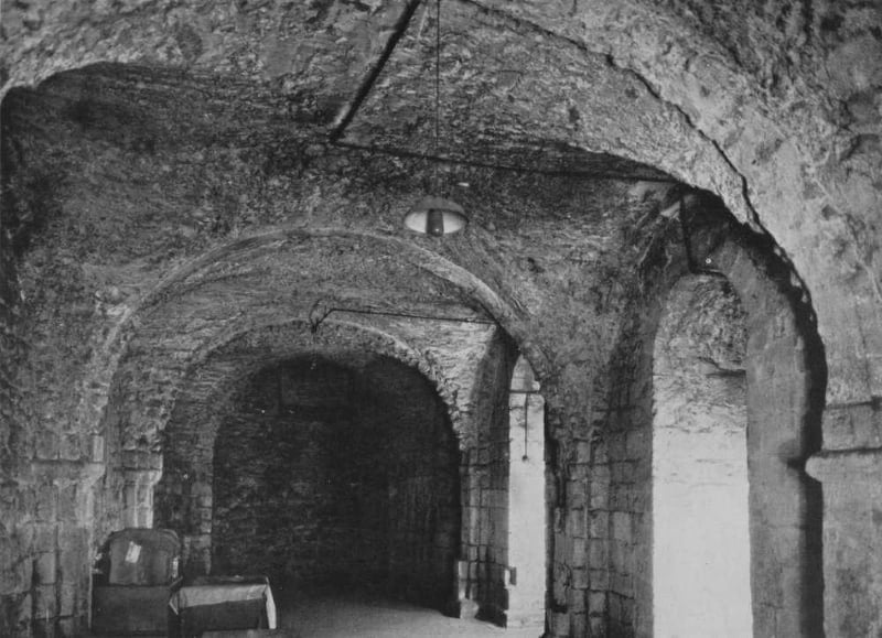 A black and white photo of the crypt without any furnishings in it.