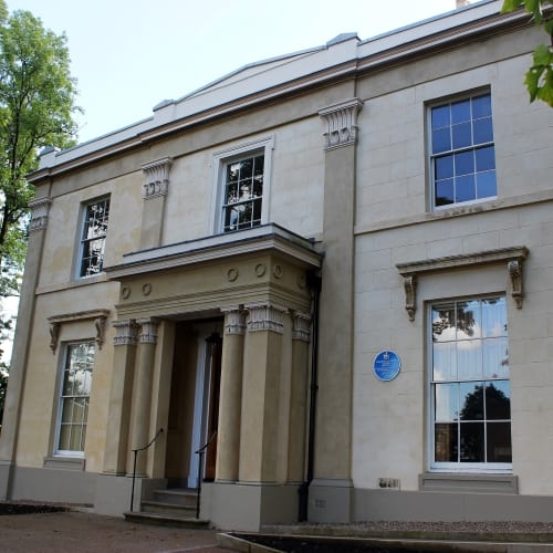 The stone exterior of Elizabeth Gaskell's house in Manchester.
