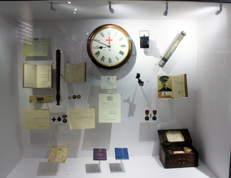 A museum display case filled with assorted objects.