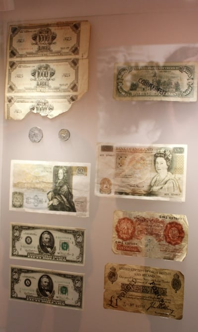 Forged bank notes and coins inside the City of London Police Museum.