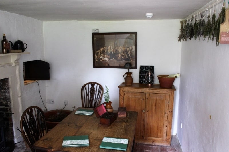 iNside Grannys parlour with a large wooden table.