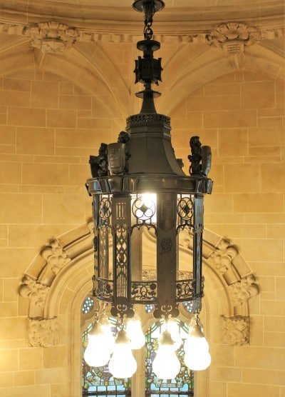 an ornate light fixture hanging inside the Supreme Court.