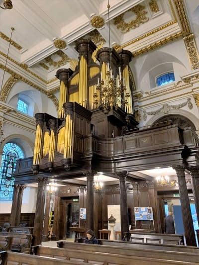 The large wooden organ takes up nearly a whole wall.