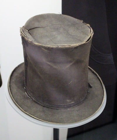An old and battered top hat in the Police Museum.