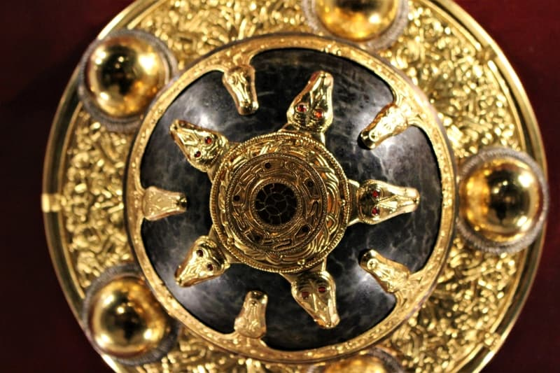 a close up of the central section of the kings shield at Sutton Hoo.