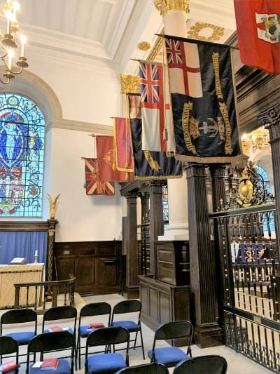 A side chapel fileld with colourful flags.