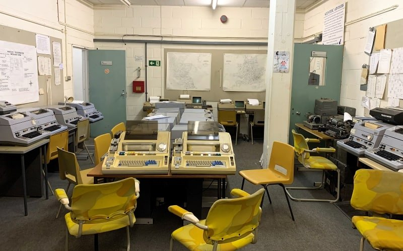 An office filled with desks, chairs and 1980s technology at the Kelvedon Hatch Nuclear Bunker.