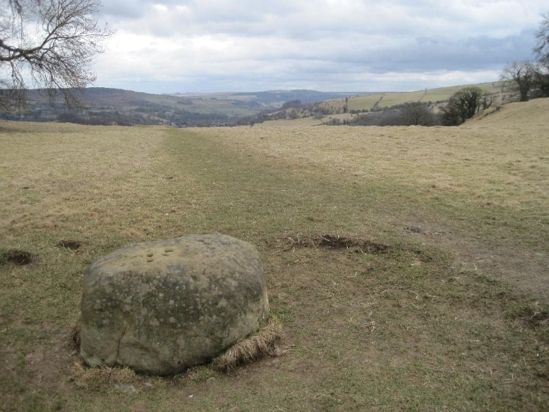 A large boundary stone on a hillside near Eyam.