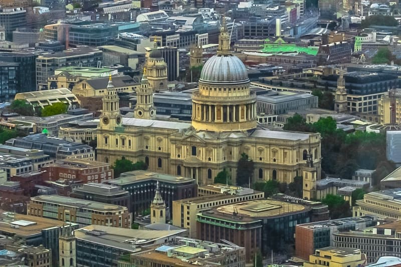 St. Paul's Cathedral surrounded by buildings in an aerial view over London.